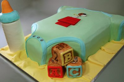 Huascar and Company Bakeshop Onesie Baby Shower Cake with Blocks and Bottle