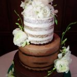 Huascar and Company BakeshopNaked Style Wedding Cake with Fresh Flowers