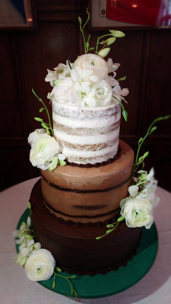 Huascar and Company BakeshopNaked Style Wedding Cake with Fresh Flowers